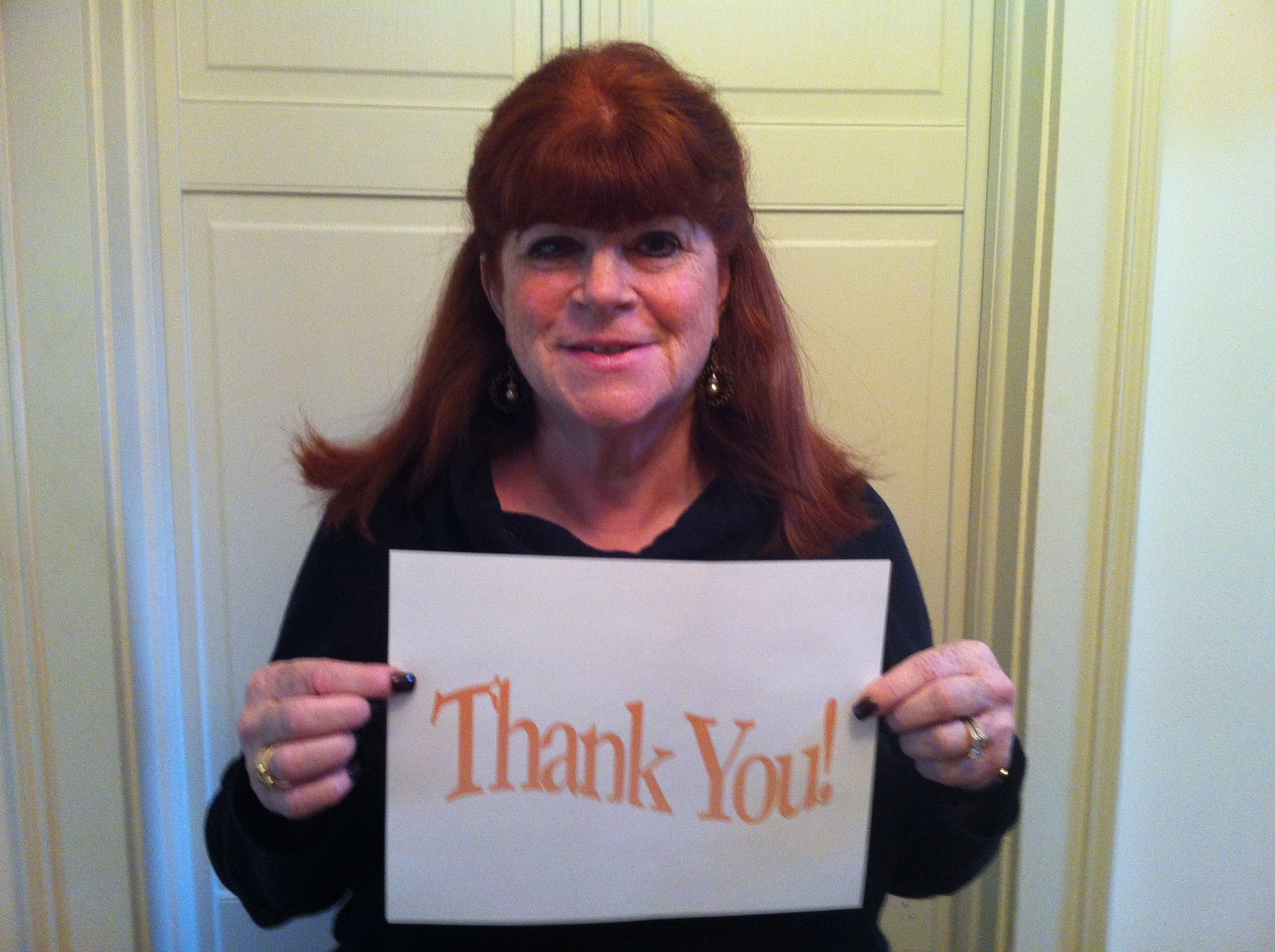 Deborah Appleman Holding Thank You Sign